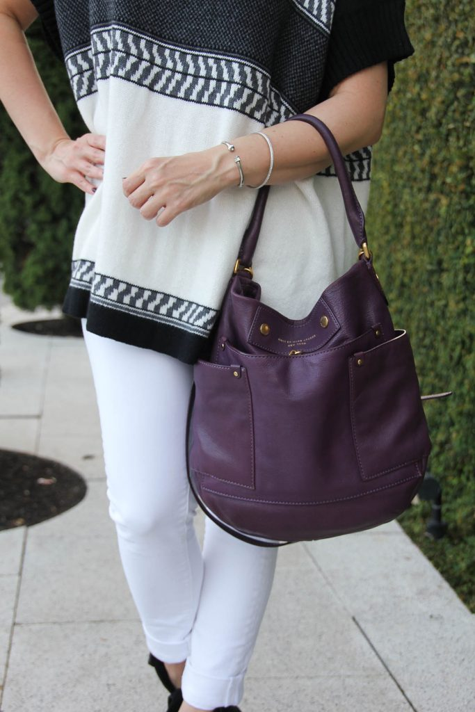 LadyinViolet carries the marc jacobs preppy leather hobo bag with her paige denim jeans.