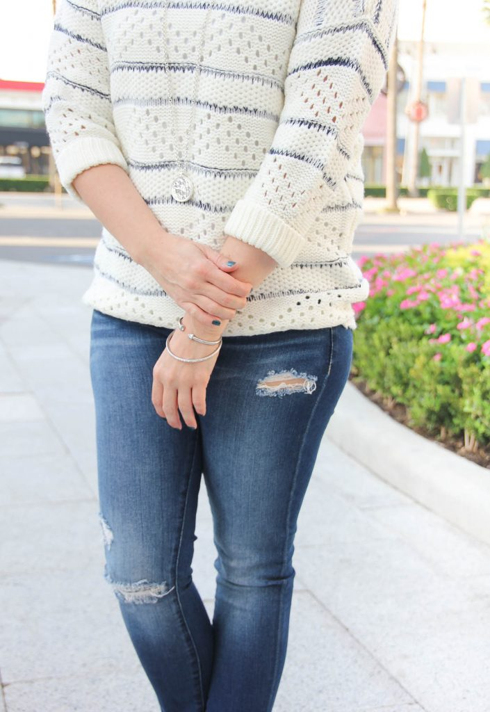 LadyinViolet wears a nordstrom fall outfit idea with a striped sweater and distressed jeans.