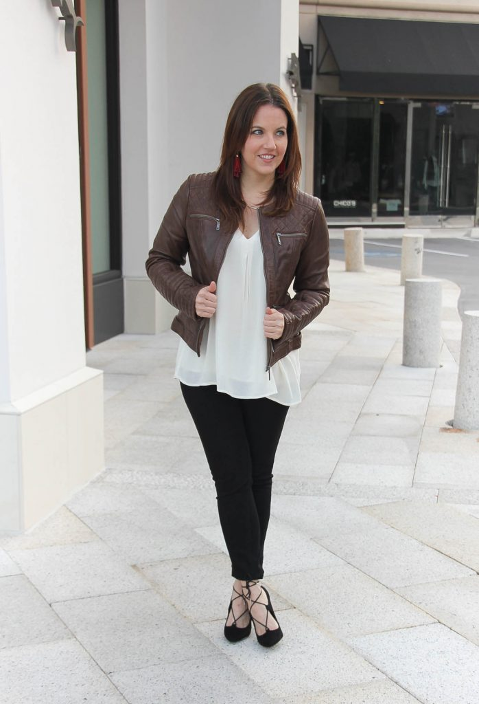 Houston Style Blogger shares a winter outfit idea featuring a brown leather jacket and lace up heels.