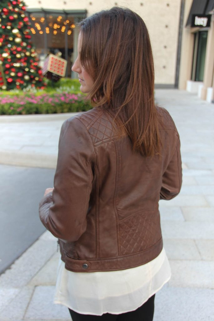 Texas Style Blogger wears a quilted brown leather jacket under 200 dollars.
