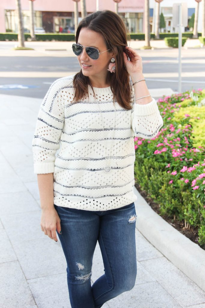 Houston Fashion blogger shares a Thanksgiving outfit idea with white sweater and jeans.