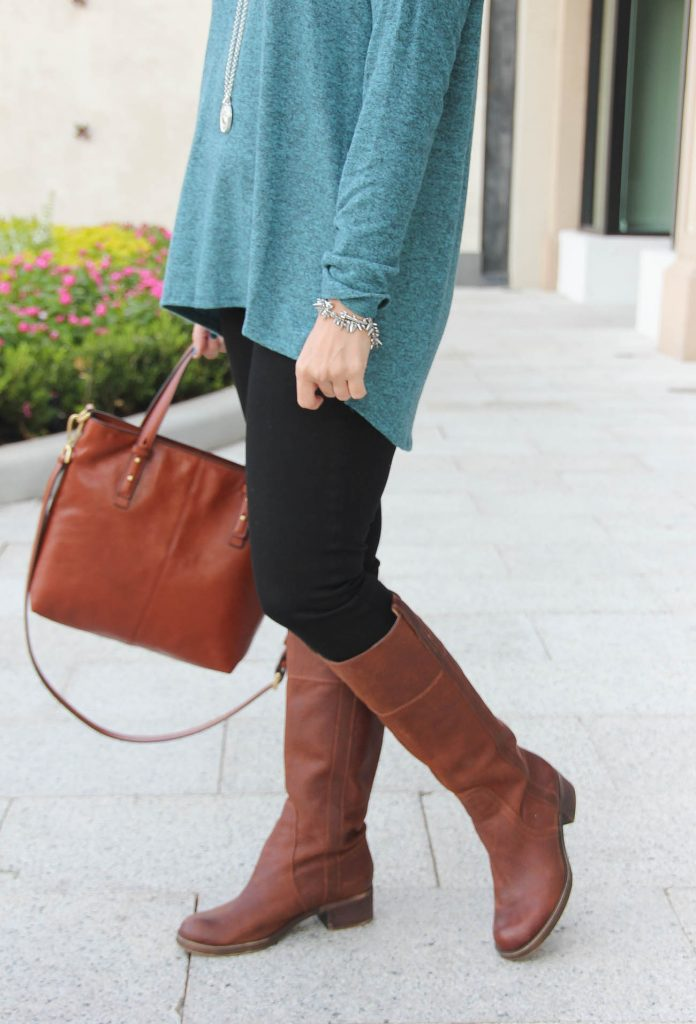 Lady in Violet wears the lucky brand heloisse riding boots.