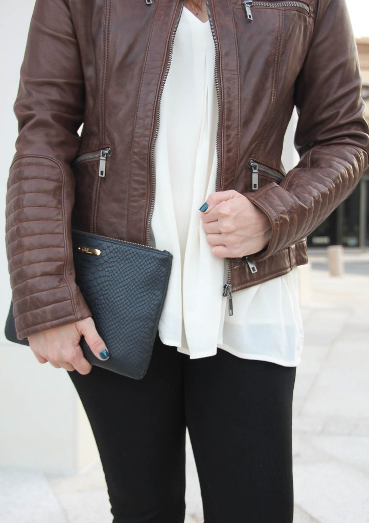 Houston Fashion Blogger wears an affordable quilted brown leather jacket.