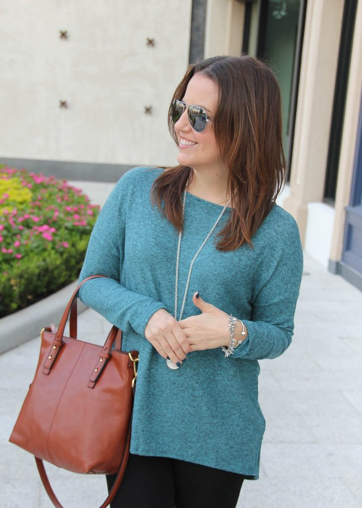 Fashion Blogger carries the Vera Bradley Sagebrush Satchel with a teal sweater under 50.