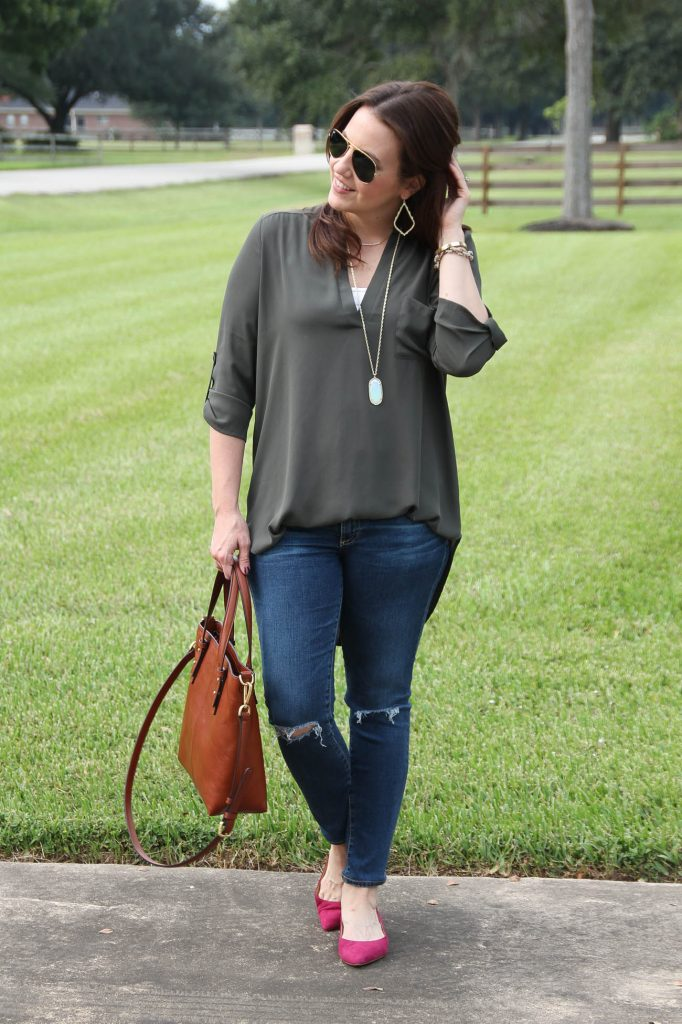 Houston Style Blogger shares a fall weekend outfit including an olive tunic and distressed jeans with pink suede flats.