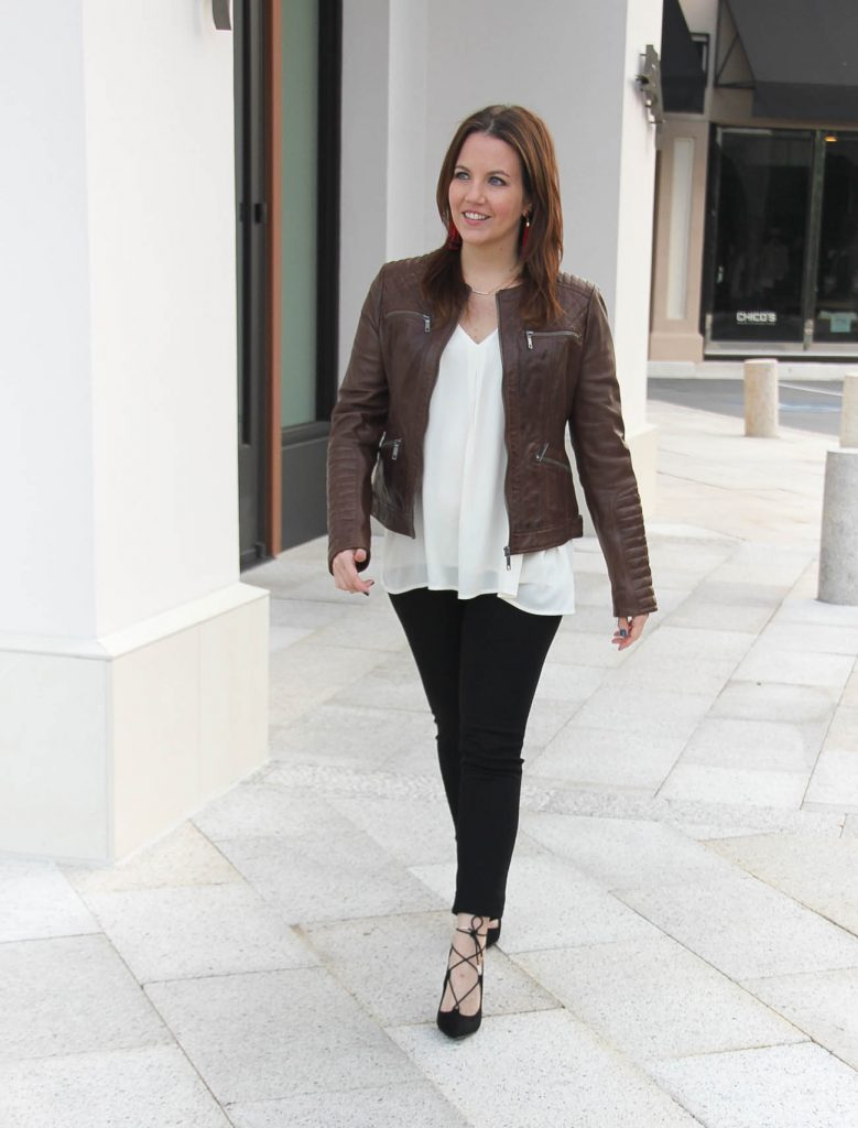 Houston Fashion blogger wears a fall outfit featuring a brown leather jacket and black lace up heels.