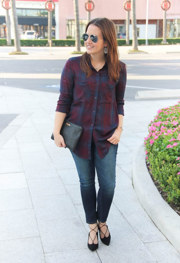 Houston Fashion Blogger styles a fall outfit idea wearing dark plaid tunic and skinny jeans.