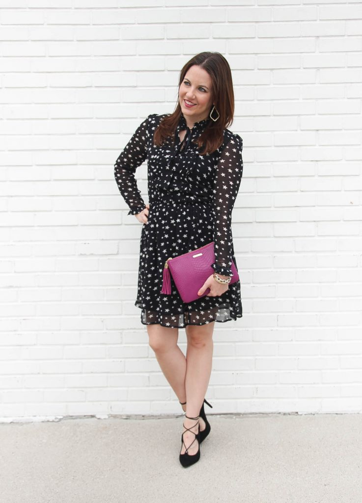 Houston Fashion Blogger, Lady in Violet wears a star print holiday dress with lace up heels and a pink clutch.