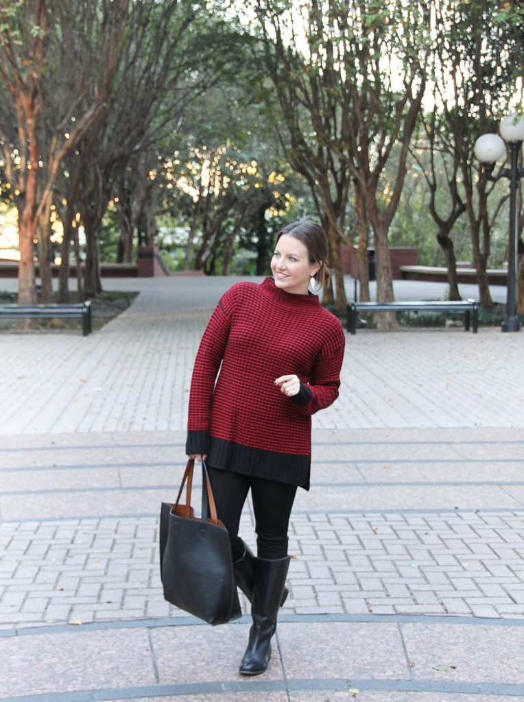 Houston Fashion Blogger wears a winter outfit idea featuring a red sweater, black jeans and riding boots.