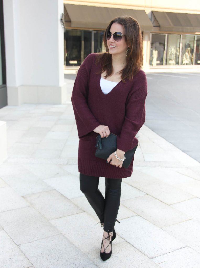 3710f3f10be Houston Fashion Bloggers wears a winter outfit with tunic sweater and leather  leggings.