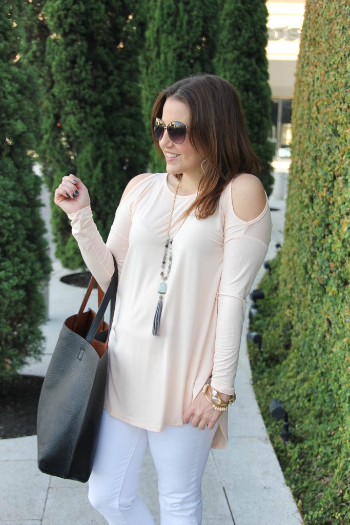 Texas Fashion Blogger wears a blush cold shoulder blouse and gray tassel necklace.