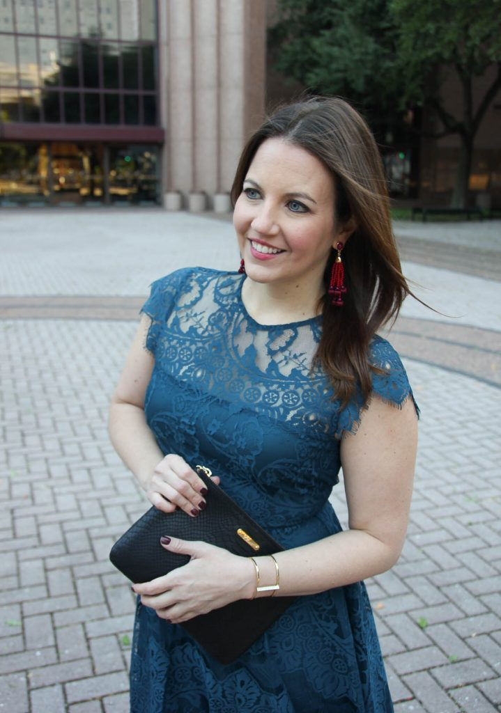 Houston Style blogger, Lady in Violet wears a Christmas party dress in teal lace with red earrings.