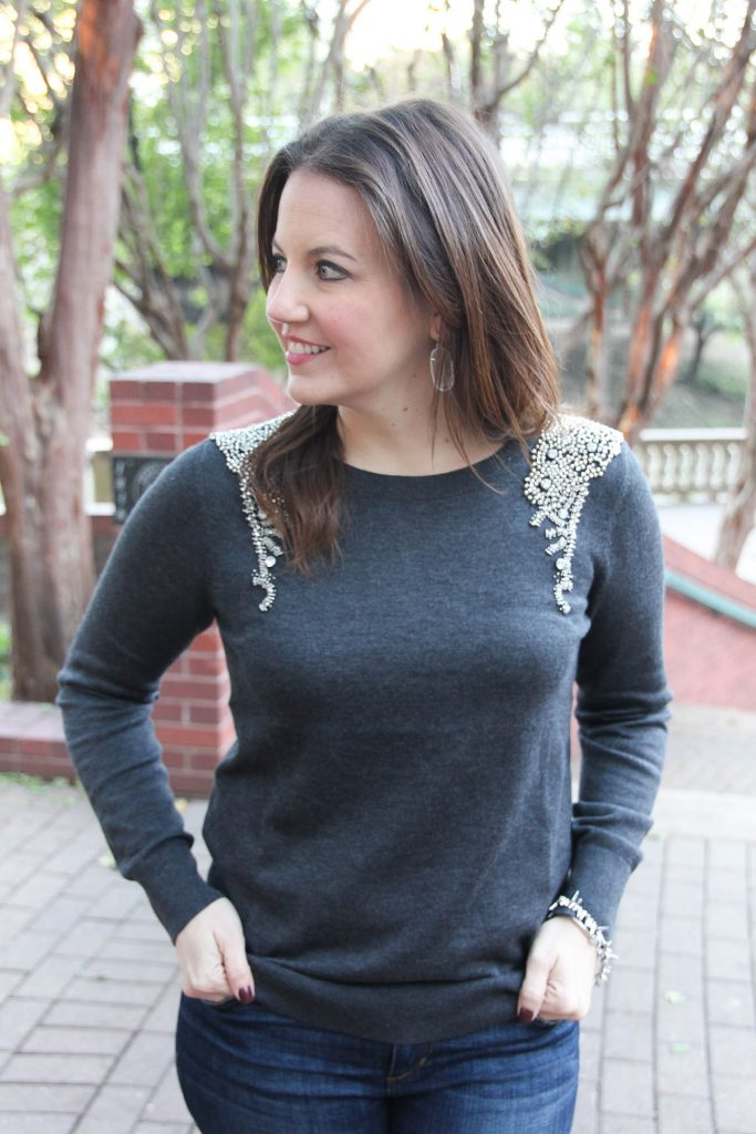 LadyinViolet wears a gray and silver embellished sweater under 100 dollars.