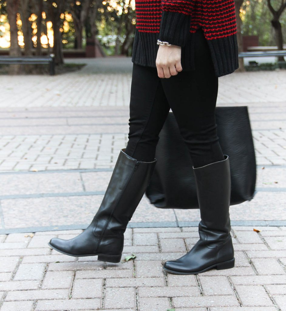 Houston Style Blogger, Karen Rock wears black riding boots with stretchy black skinny jeans.