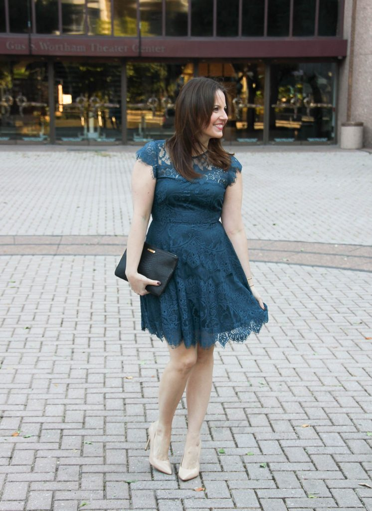 Houston Fashion Blogger Karen Rock wears a cocktail party dress with nude heels and red tassel earrings.