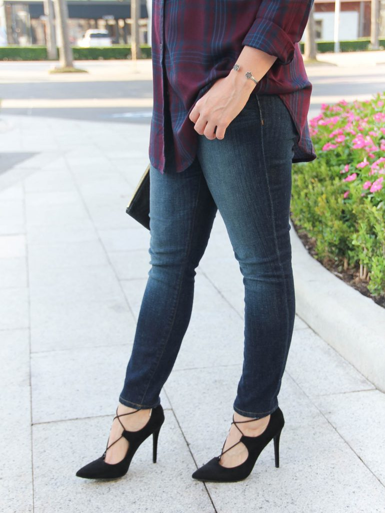 Texas Fashion Blogger wears Joes Jeans dark skinny jeans with black laceup heels.