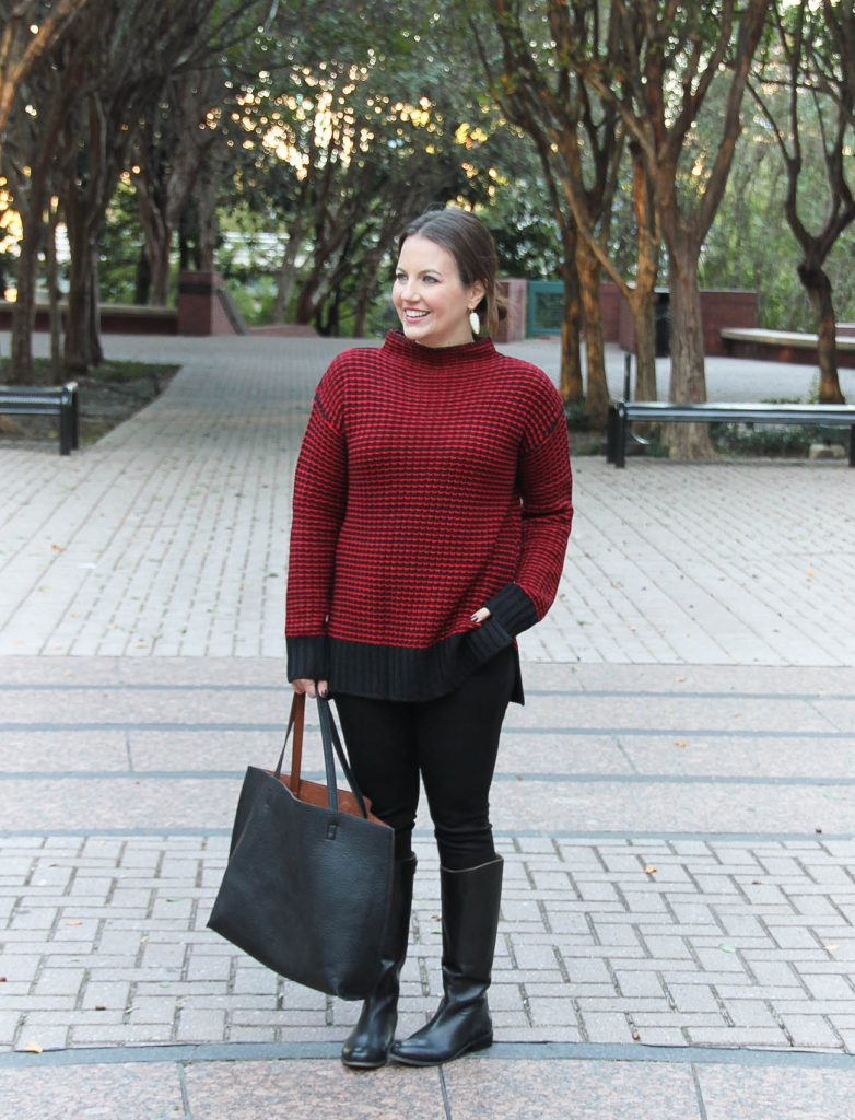 Houston Fashion Blogger, Karen Rock wears a Christmas outfit idea including a red sweater, black jeans and boots.