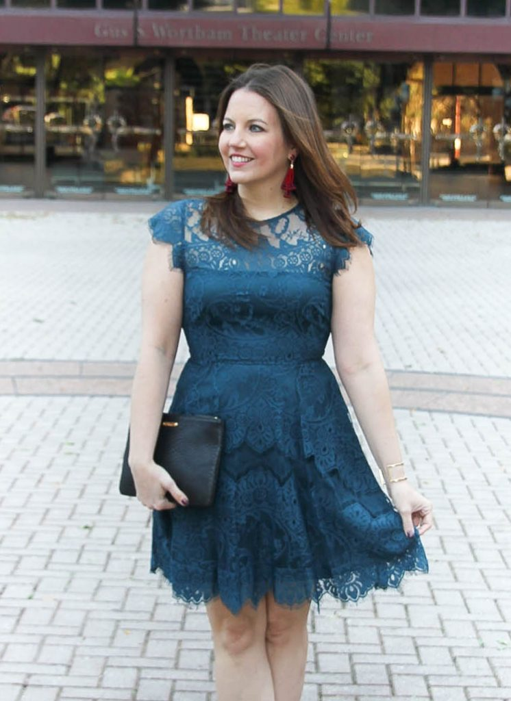 Houston Fashion blogger Lady in Violet styles the BB dakota lace dress in teal with baublebar astolat earrings for a holiday party outfit idea.