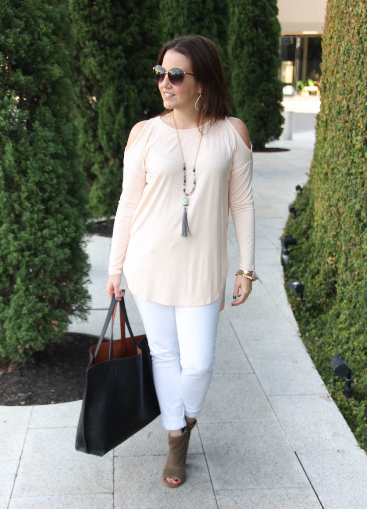 Houston Fashion Bloggers wears a casual weekend outfit including white jeans and a cold shoulder pink top.