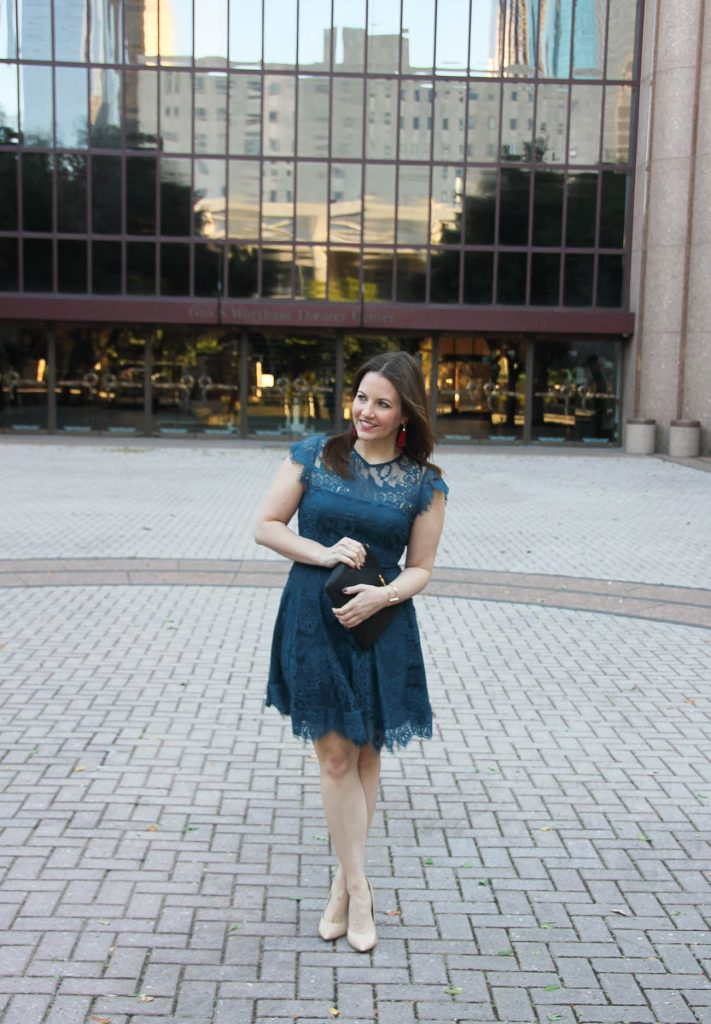 Karen Rock of Lady in Violet styles a wedding guest outfit in a teal dress and blush nude heels in downtown Houston.