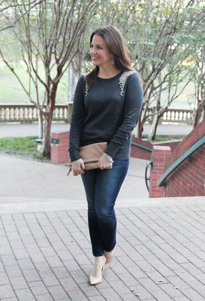 Houston Fashion Blogger shares winter outfit ideas for the holidays including an embellished sweater with dark jeans and nude heels.
