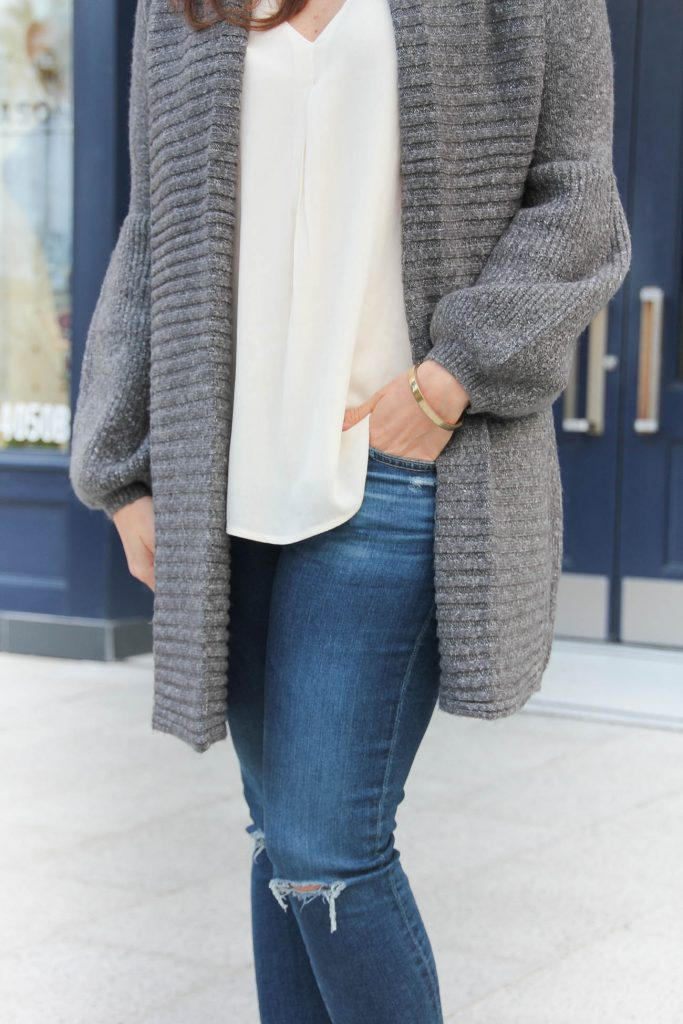 Houston Fashion blogger wears a layered casual outfit idea for winter with a long cardigan and white tank.