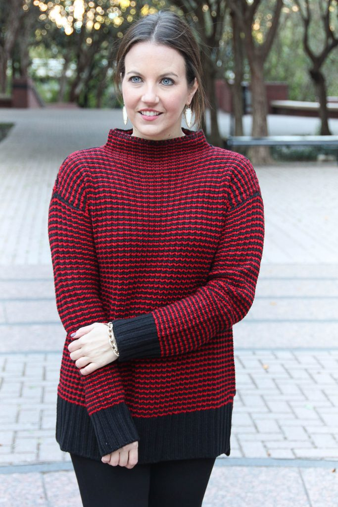 Karen Rock of the Houston fashion blog, Lady in Violet wears a comfy red sweater that is perfect for Christmas Day.