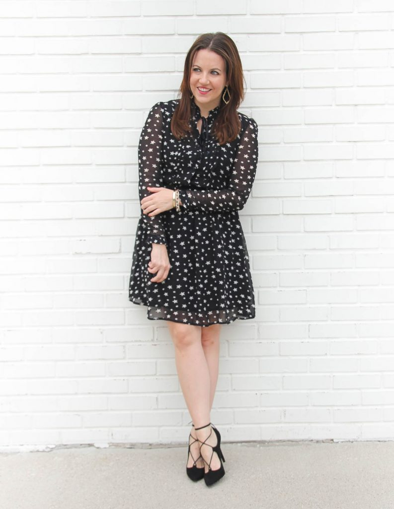 Houston Fashion Blogger, Lady in Violet styles a holiday party outfit idea with a star print dress and black lace up heels.