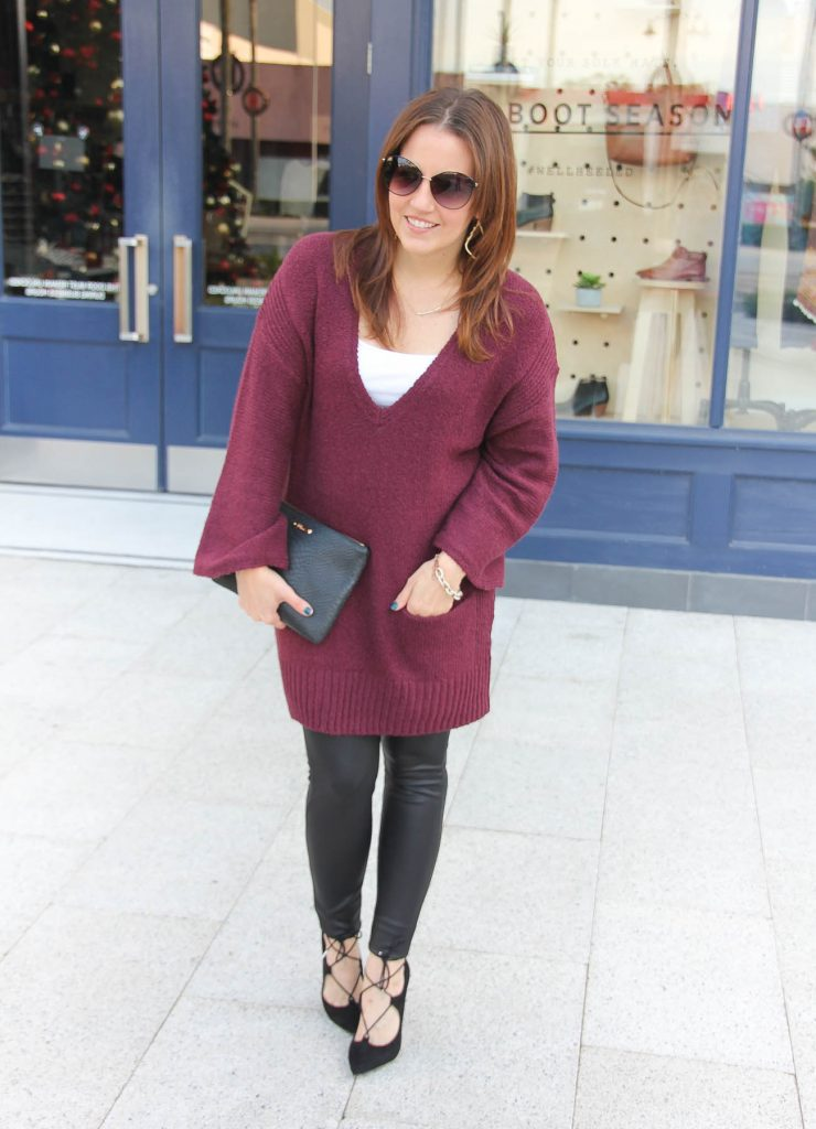 d9faaaec8b3 Houston fashion blogger styles a winter outfit idea featuring leather  leggings and a burgundy sweater.