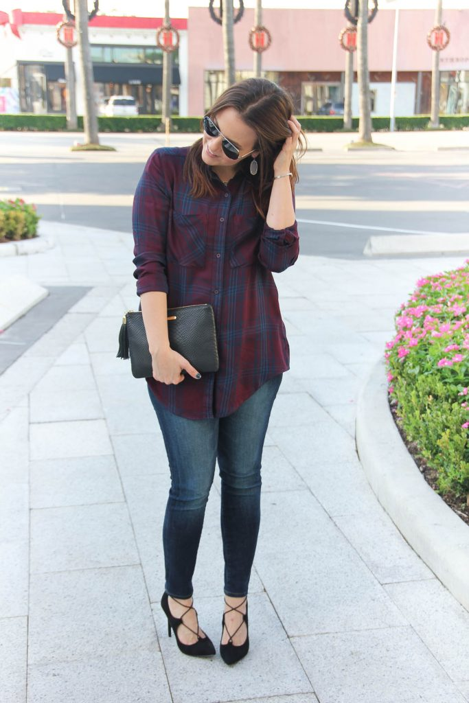 Houston Fashion Blogger wears a Thanksgiving outfit idea including a plaid top and lace up heels.