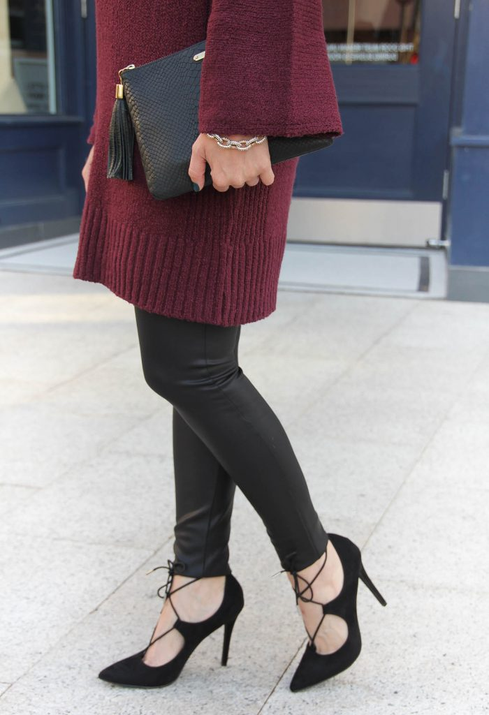 d0a385bd369 LadyinViolet wears the best faux leather leggings under 50 dollars. Houston  Fashion Blogger wears a burgundy sweater ...