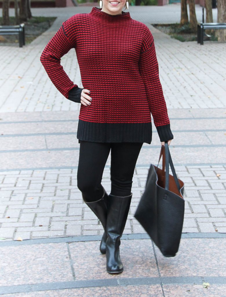 Houston Style Blogger wears a cold weather outfit including a red sweater, black jeans, and riding boots.
