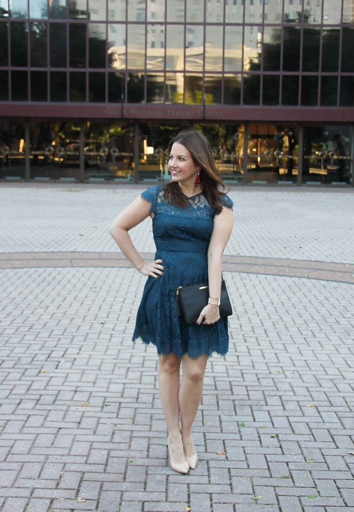 Houston Fashion Blogger Lady in Violet styles a Holiday outfit idea in a teal lace dress from Nordstrom with heels and red earrings from Baublebar.