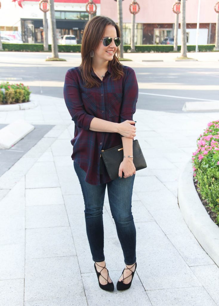 Houston Fashion Bloggers styles a fall weekend outfit featuring a plaid blouse and skinny jeans with heels.