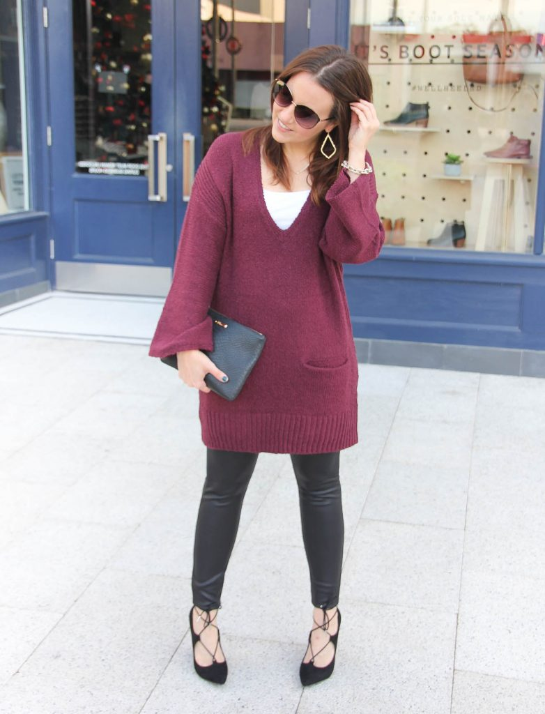 Houston fashion blogger wears a tunic sweater with leather leggings and laceup heels.