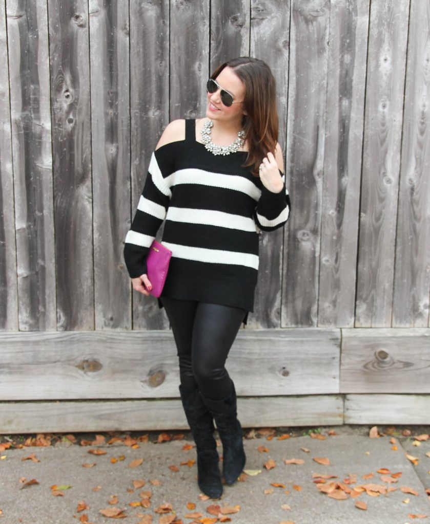 Houston Fashion Blogger Lady in Violet wears a casual new year's eve outfit with a cold shoulder sweater and leather leggings with suede boots.