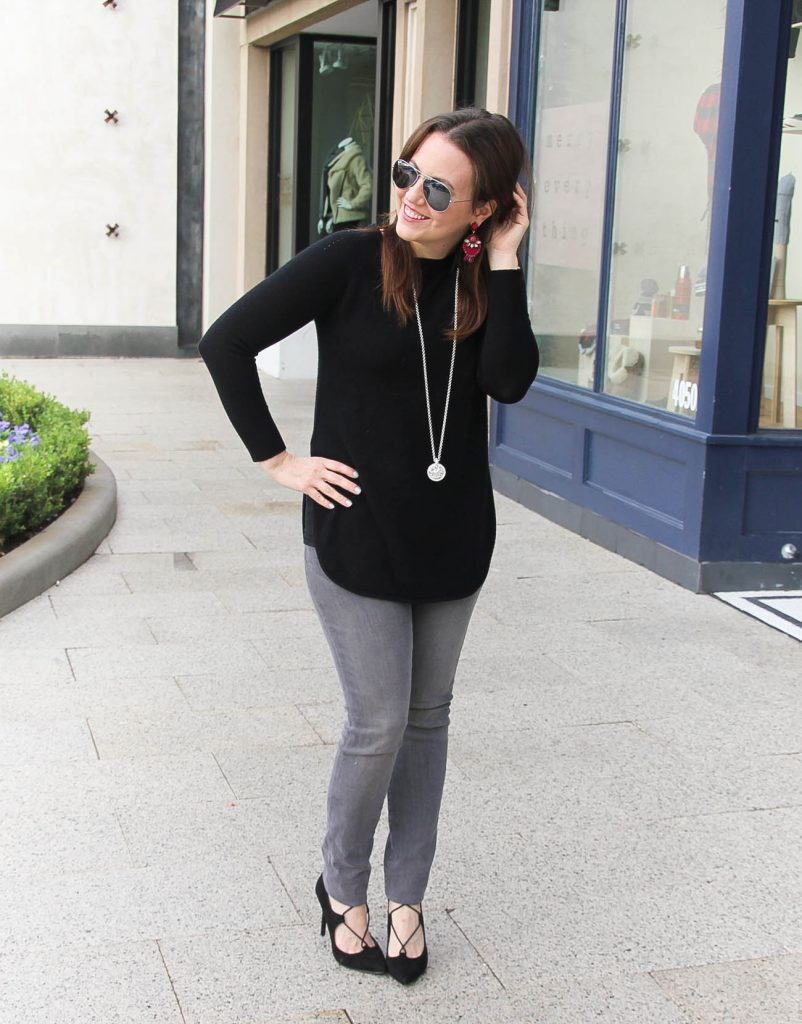 Houston Fashion Blogger Lady in Violet styles a winter outfit idea featuring a wool cashmere sweater with gray jeans and lace up heels.