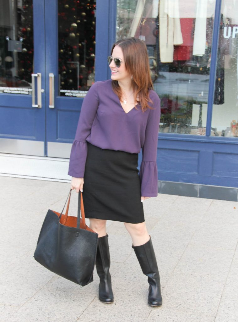 Houston Fashion Blogger, Lady in Violet styles a winter work outfit including a bell sleeve blouse, black pencil skirt, and black riding boots.