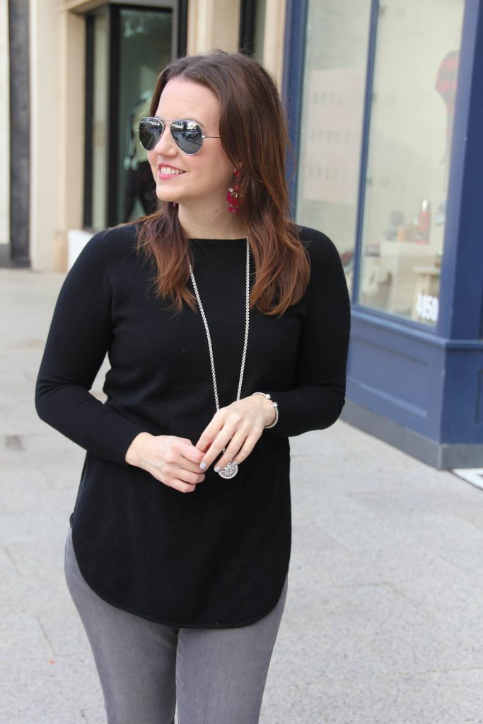 Houston Fashion Blogger Lady in Violet wears a black tunic sweater and Baublebar pink statement earrings.