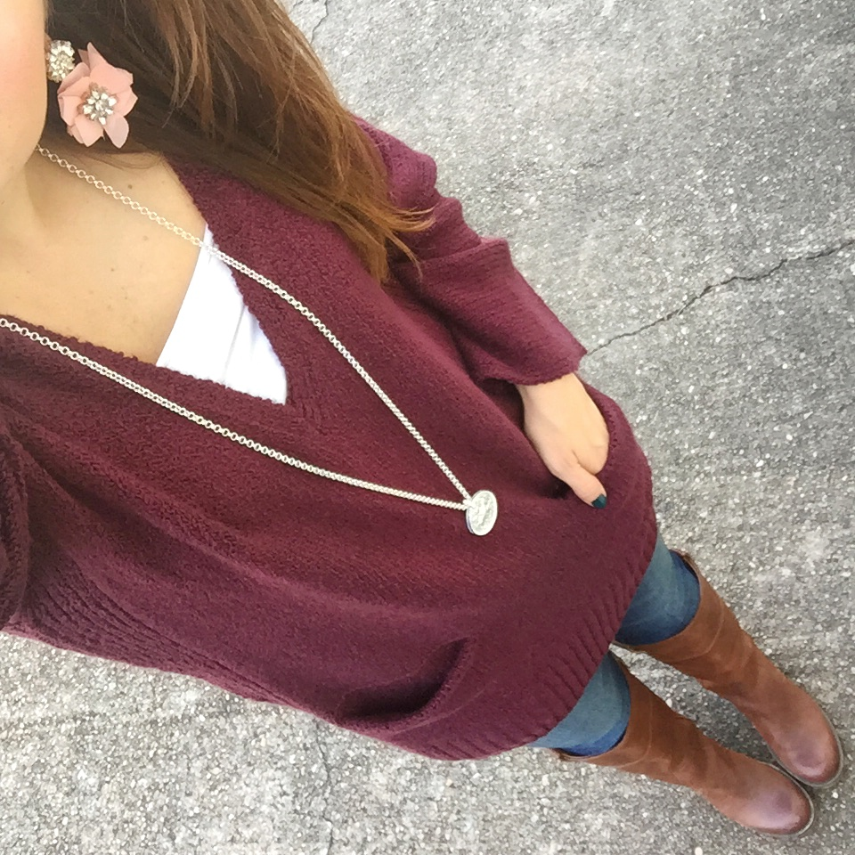 Houston fashion blogger Karen Rock wears a casual winter outfit with a long maroon sweater with brown boots.