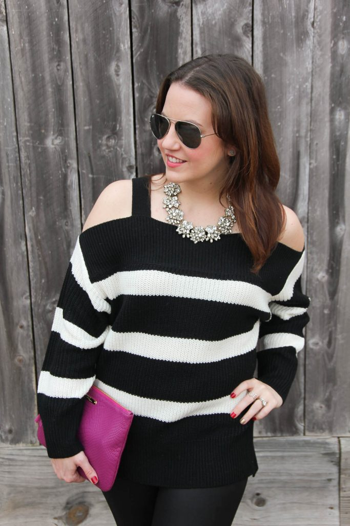 Houston style blogger Lady in Violet wears a cute statement necklace with a cold shoulder striped sweater for a winter outfit idea.