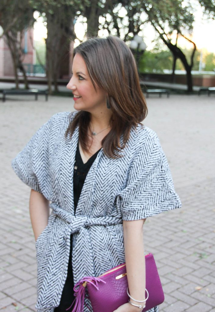 Houston Fashion blogger, lady in violet shows how to wear a wrap coat to a Christmas party.