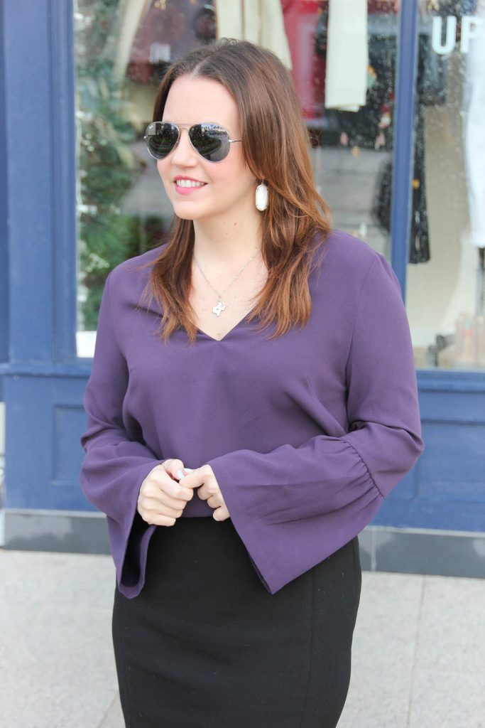 Houston Style Blogger Lady in Violet wears a work outfit including a purple bell sleeve blouse and Texas necklace.