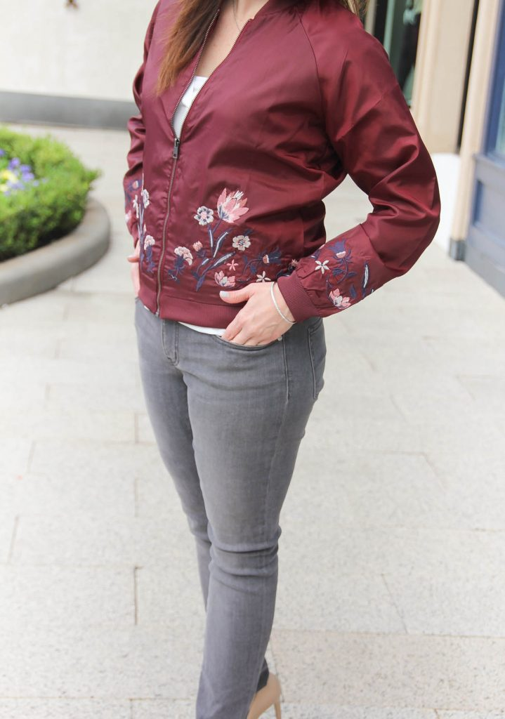 Houston Style Blogger Karen Rock of Lady in Violet wears gray skinny jeans under 50 with a burgundy bomber jacket for fall outfit idea.