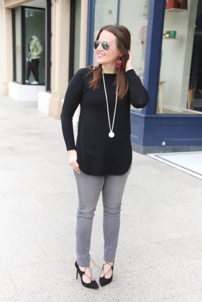 Houston Fashion Blogger Lady in Violet styles a winter outfit idea featuring a black sweater with gray jeans and black lace up heels.