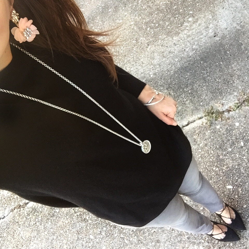 Houston Style blogger wears a winter outfit idea with a black cashmere sweater and gray skinny jeans.