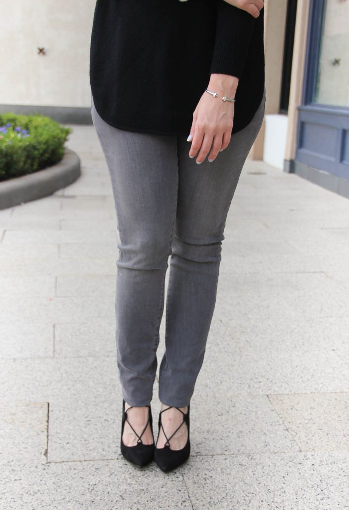 Houston Style Blogger Lady in Violet wears gray skinny jeans under 50 with black lace up heels.
