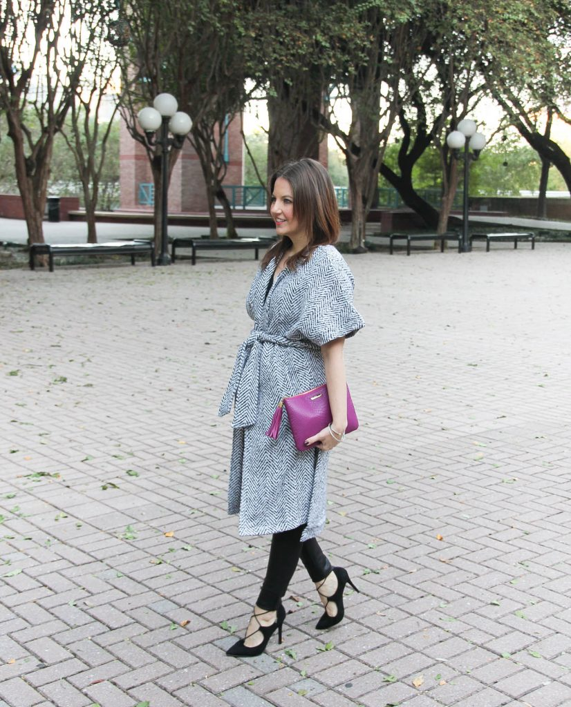 Houston fashion blogger, Lady in Violet wears a winter outfit featuring a wrap coat and leather leggings.