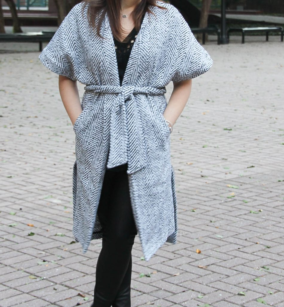 Houston style blogger styles a holiday party outfit featuring a long wrap cot and faux leather leggings.