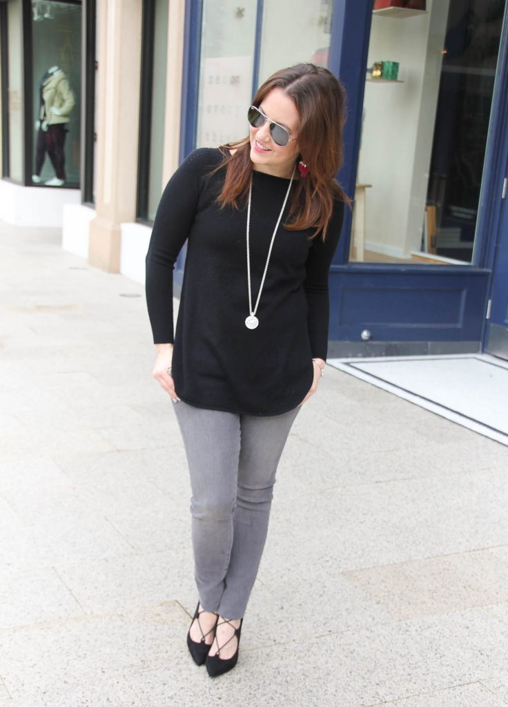 Houston Style blogger shares a winter weekend outfit featuring a black tunic sweater and gray skinny jeans with lace up heels.